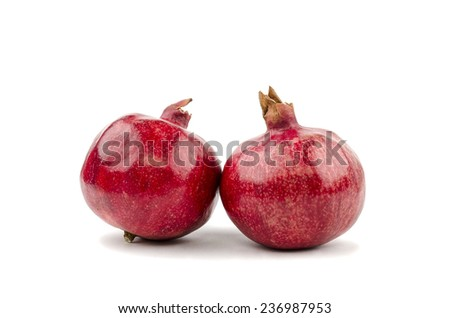 Two pomegranate on a white background - stock photo
