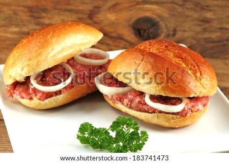 two pork bun on plate garnished  - stock photo