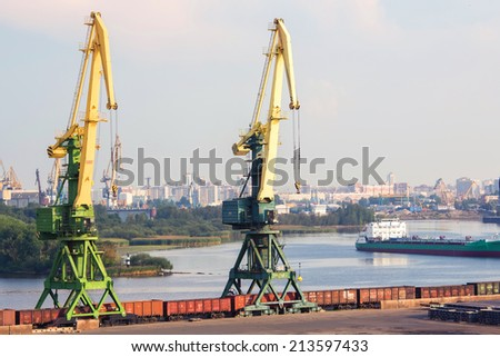 Two port cranes with cargo train. Port of St.Petersburg, Russia - stock photo