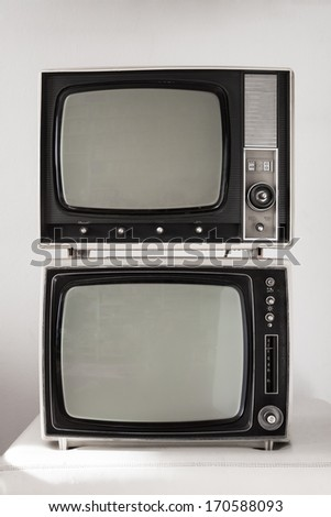 Two portable vintage televisions on white background - stock photo