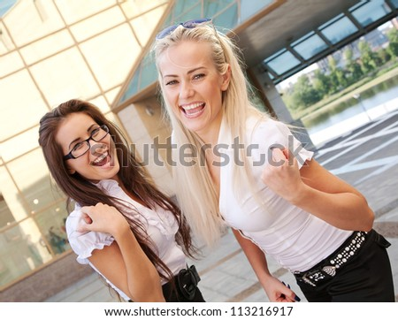 two positive students showing success - stock photo