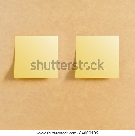 Two post it on brown board texture - stock photo