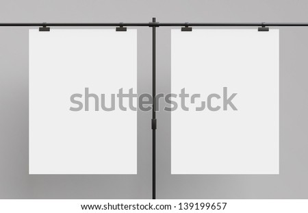 two poster sandwiched metal clasps - stock photo
