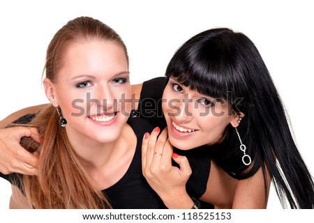 Two pretty girlfriend in black dresses on a white background - stock photo