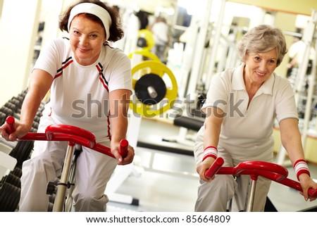 Two pretty senior women in health club - stock photo