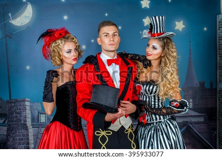two pretty young blonde girls with men in formal retro clothes dancing Broadway style - stock photo