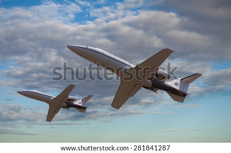 Two private jets flying close to each other - stock photo