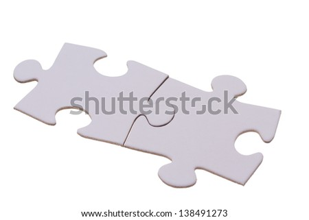 Two puzzle bricks fitting together - stock photo