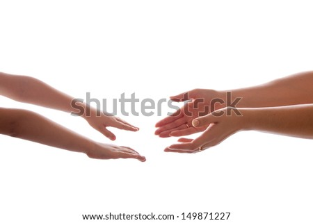 Two reaching hands, mother and son isolated - stock photo