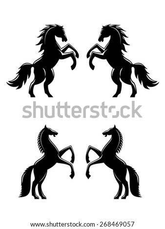 Two rearing up horses silhouettes in black for heraldry design - stock photo
