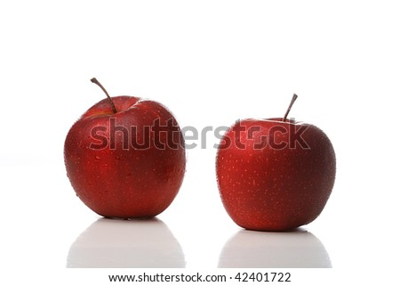 Two red apples with waterdrops isolated on white background - stock photo