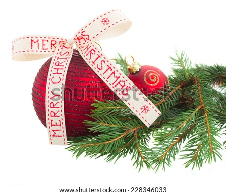 Two Red Christmas balls with evergreen twig isolated on white background - stock photo