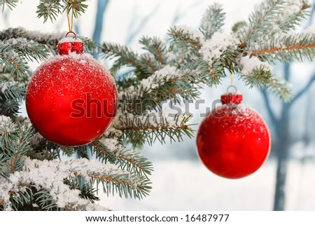Two Red Christmas baubles on a snowy scene - stock photo