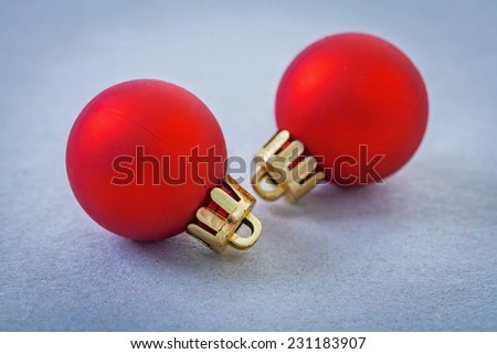 two red christmas baubles selective focus - stock photo