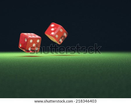 Two red dice thrown on green table. Your text on the empty space. - stock photo