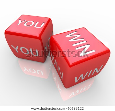 Two red dice with the words You Win on them - stock photo