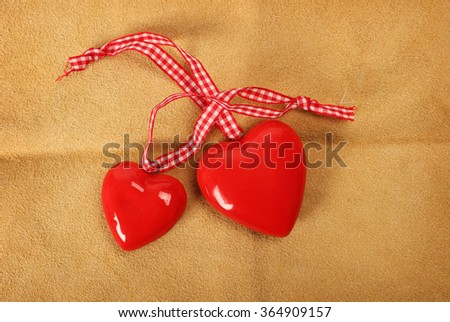 two red hearts on leather background - stock photo