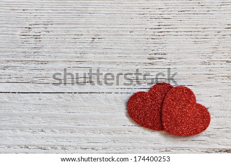 two red hearts on white wooden background  - stock photo
