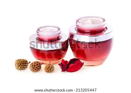 Two red jars with moisturizing face cream on a white background - stock photo