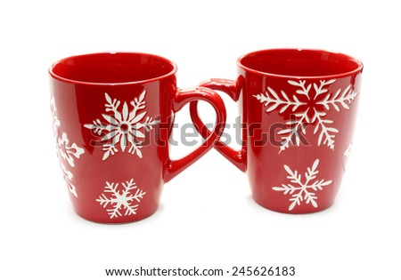 Two red mugs isolated on white - stock photo