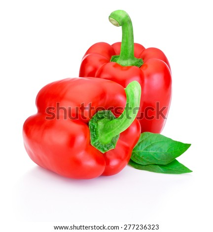 Two Red Peppers with green leaves isolated on white background - stock photo
