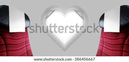Two red seat beside window plane heart shape - stock photo