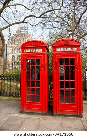 Two red telephone box outside the natural history museum. London, UK. - stock photo