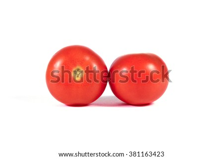 Two red tomatoes macro or close up isolated on white background - stock photo