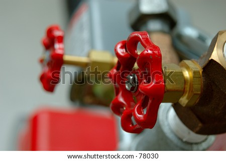 Two Red Valve Handles - stock photo