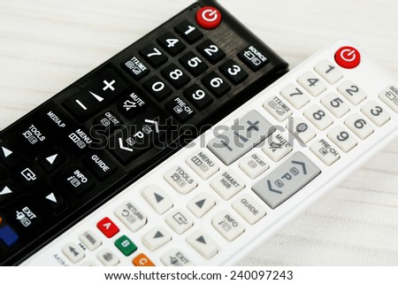Two remote control devices on table - stock photo