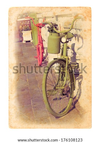 Two retro bicycles on the street in Amsterdam. Old bicycle on grunge textured paper. Vintage postcard with painted bicycles on dirty paper background. - stock photo