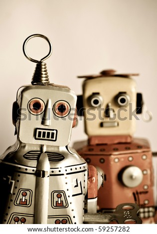 two retro robot toys - stock photo