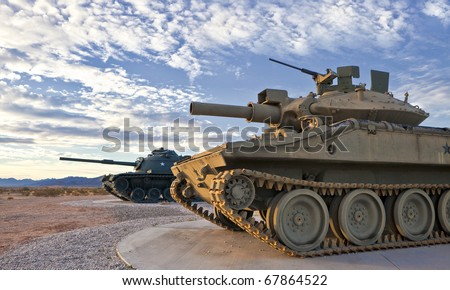 Two Retro Tanks at Sunrise - stock photo