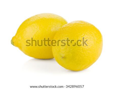 Two ripe lemons. Isolated on white background - stock photo