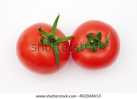 Two ripe red tomatoes  - stock photo