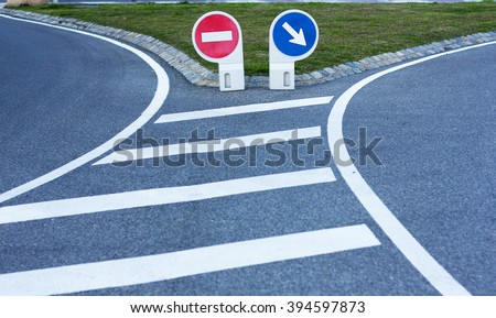 Two road signs on a fork.Pointer direction and stop sign. - stock photo
