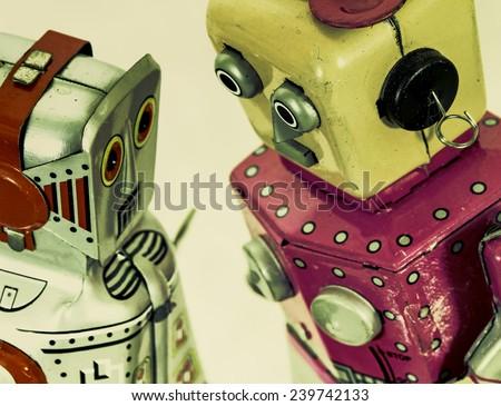 two robot toys talk - stock photo