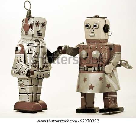 two robots together - stock photo