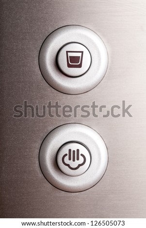 Two round buttons, coffee cup and steam - stock photo