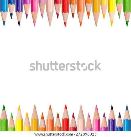 Two rows of colored pencils in front of white background, color concept with copy space in the center of the  photo - stock photo