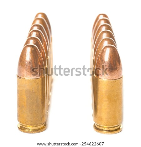 Two rows of 9mm bullets isolated on white background - stock photo