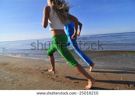 Two running girls - stock photo