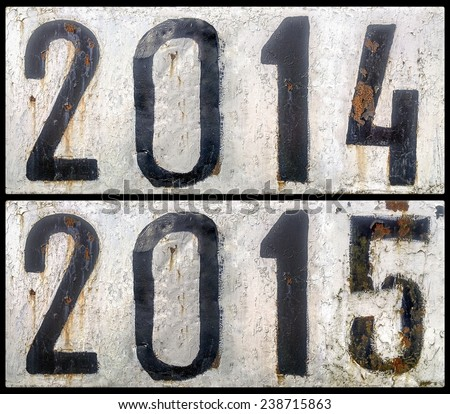 two rusty metal plates with a painted numbers 2014 and 2015. new year - stock photo