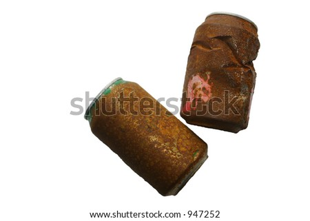 Two rusty tin cans, found on the beach. - stock photo