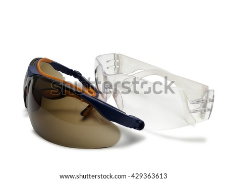 Two safety glasses isolated on white background. - stock photo