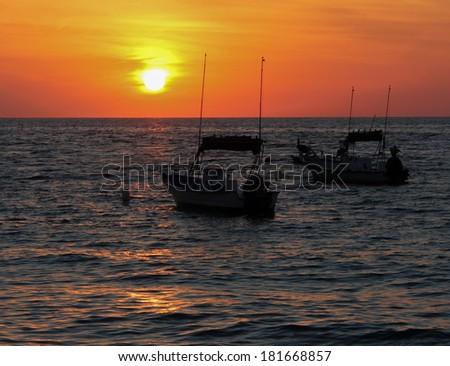 two sailboats in the harbor at Puerto Vallarta Mexico - stock photo