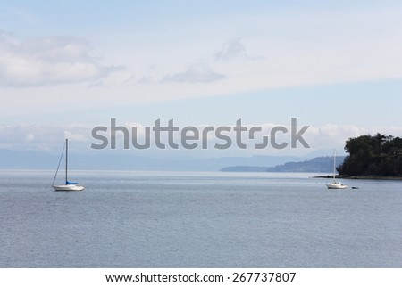Two sailboats moored in a bay - stock photo
