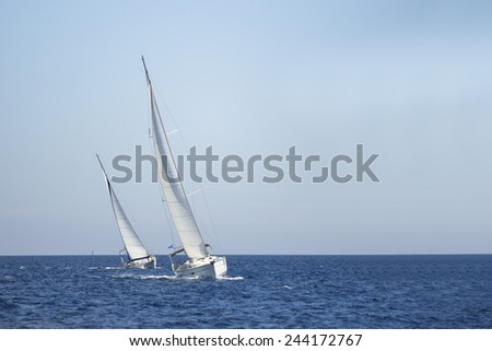 Two sailboats on the sea. Sailing. Luxery yachts. - stock photo