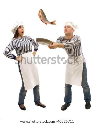 Two sailors preparing fish - stock photo