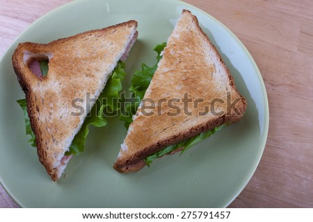 two salad sandwiches on brown toasted bread - stock photo